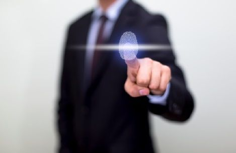 Employee Using Biometric Fingerscanning